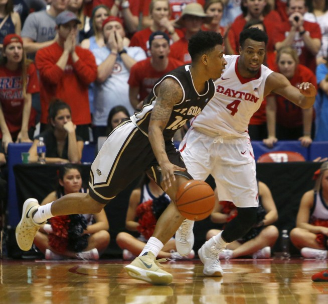 Feb 20, 2016; Dayton, OH, USA; St. Bonaventure Bonnies guard Jaylen Adams (10) drives against Dayton Flyers guard Charles Cooke (4) during the second half at University of Dayton Arena. St. Bonaventure won 79-72. Mandatory Credit: David Kohl-USA TODAY Sports