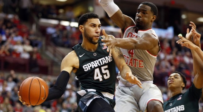 Feb 23, 2016; Columbus, OH, USA; Michigan State Spartans guard Denzel Valentine (45) speeds past Ohio State Buckeyes center Daniel Giddens (4) during the second half at Value City Arena. The Spartans won 81-62. Mandatory Credit: Joe Maiorana-USA TODAY Sports