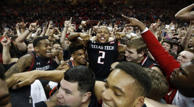 Texas Tech's Devon Thomas is hoisted in the crowd after Texas Tech defeated Oklahoma 65-63 in an NCAA basketball game Wednesday, Feb. 17, 2016, in Lubbock, Texas. (AP Photo/Brad Tollefson) ORG XMIT: TXBT108