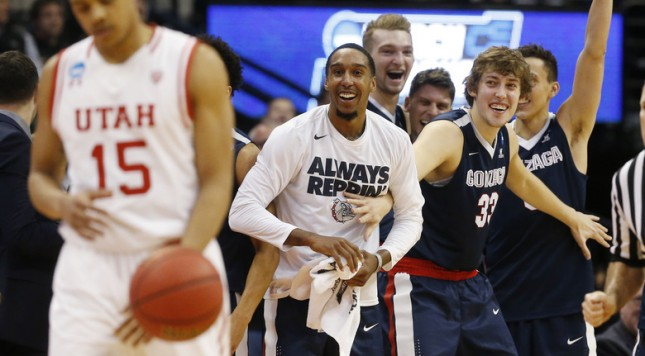 Utah guard Lorenzo Bonam, front, reacts as Gonzaga guard Eric McClellan, forward Kyle Wiltjer and Gonzaga guard Kyle Dranginis celebrate late in the second half of a second-round men's college basketball game Saturday, March 19, 2016, in the NCAA Tournament in Denver. Gonzaga won 82-59. (AP Photo/Brennan Linsley)