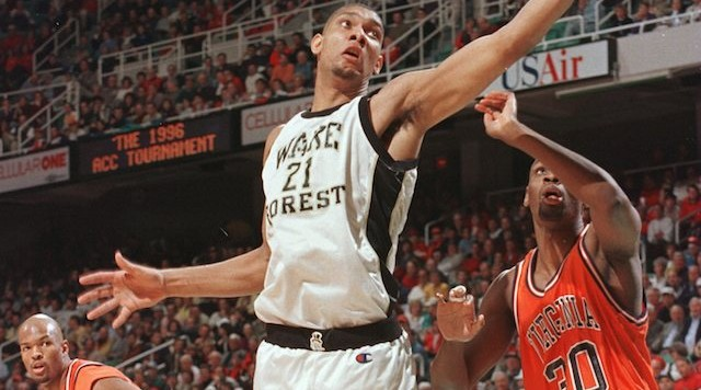 8 Mar 1996:  Tim Duncan of the Wake Forest Demon Deacons lays the ball up as Chris Alexander #30 of the Virginia Cavaliers looks on in the quarterfinals of the ACC Tournament at the Greensboro Coliseum in Greensboro, North Carolina. Mandatory Credit: Doug