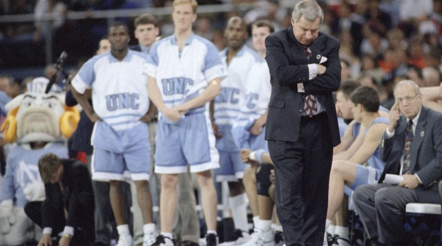 University of North Carolinas coach Dean Smith, right, reacts to the closing moments of their loss to the University of Arkansas in the NCAA Final Four game, Saturday, April 1, 1995, Seattle, Wash. Arkansas won 75-68 to advance to Mondays championship game. (AP Photo/Eric Draper)