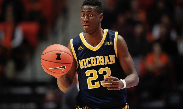 CHAMPAIGN, IL - DECEMBER 30: Caris LeVert #23 of the Michigan Wolverines brings the ball up court during the game against the Illinois Fighting Illini at State Farm Center on December 30, 2015 in Champaign, Illinois.  (Photo by Michael Hickey/Getty Images)