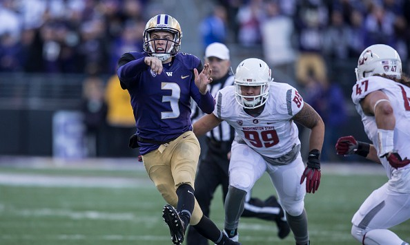 SEATTLE, WA - NOVEMBER 27: Quarterback Jake Browning #3 of the Washington Huskies passes the ball as defensive lineman Darryl Paulo #99 of the Washington State Cougars and linebacker Peyton Pelluer #47 of the Washington State Cougars pursue during the second half of a football game at Husky Stadium on November 27, 2015 in Seattle, Washington. The Huskies won the game 45-10. (Photo by Stephen Brashear/Getty Images)