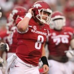 Sep 6, 2014; Fayetteville, AR, USA; Arkansas Razorbacks quarterback Austin Allen (8) after scoring a touchdown in the fourth quarter against the Nicholls State Colonels at Donald W. Reynolds Razorback Stadium. Arkansas defeated Nicholls State 73-7. Mandatory Credit: Nelson Chenault-USA TODAY Sports