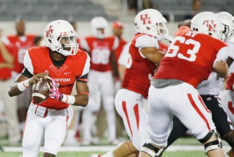 HOUSTON, TX - OCTOBER 17:  Greg Ward Jr. #1 of the Houston Cougars looks to pass against the Temple Owls in the first half of their game at TDECU Stadium on October 17, 2014 in Houston, Texas.  (Photo by Scott Halleran/Getty Images)