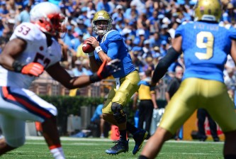 """UCLA quarterback Josh Rosen (3) against Virginia Cavaliers in the first half of a NCAA college football game at the Rose Bowl in Pasadena, Calif., Saturday, Sept. 5, 2015. (Photo by Keith Birmingham/ Pasadena Star-News)   """