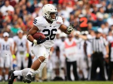JACKSONVILLE, FL - JANUARY 02: Saquon Barkley #26 of the Penn State Nittany Lions in action during the TaxSlayer Bowl game against the Georgia Bulldogs at EverBank Field on January 2, 2016 in Jacksonville, Florida.  (Photo by Rob Foldy/Getty Images)