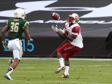 Western Kentucky wide receiver Taywan Taylor gets a long pass during the second quarter of the Miami Beach Bowl game on Monday, Dec. 21, 2015, at Marlins Park in Miami. (Hector Gabino/El Nuevo Herald/TNS via Getty Images)