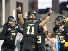 MONTGOMERY, AL - DECEMBER 19: Quarterback Taylor Lamb #11 of the Appalachian State Mountaineers celebrates with teammates after scoring a touchdown during their game against the Ohio Bobcats at the Raycom Media Camellia Bowl on December 19, 2015 at the Cramton Bowl in Montgomery, Alabama. (Photo by Michael Chang/Getty Images)