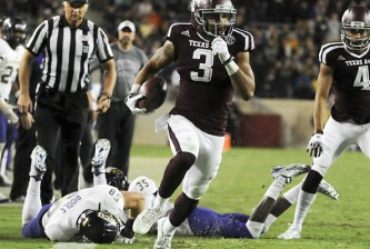 COLLEGE STATION, TX - NOVEMBER 14: Christian Kirk #3 of the Texas A&M Aggies runs for a 22-yard touchdown reception in the fourth quarter of a NCAA football game against the Western Carolina Catamounts at Kyle Field on November 14, 2015 in College Station, Texas. (Photo by Eric Christian Smith/Getty Images)