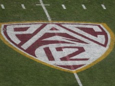 """TEMPE, AZ - OCTOBER 19:  The """"Pac 12"""" logo is displayed on the filed during the college football game between the Washington Huskies and the Arizona State Sun Devils at Sun Devil Stadium on October 19, 2013 in Tempe, Arizona.  The Sun Devils defeated the Huskies 53-24.  (Photo by Christian Petersen/Getty Images)"""