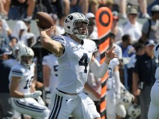 PROVO, UT - SEPTEMBER 20: Quarterback Taysom Hill #4 of the Brigham Young Cougars prepares to pass during their game against the Virginia Cavaliers at LaVell Edwards Stadium on September 20, 2014 in Provo, Utah. (Photo by Gene Sweeney Jr/Getty Images )
