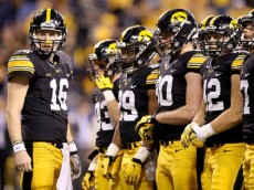 INDIANAPOLIS, IN - DECEMBER 05: C.J. Beathard #16 of the Iowa Hawkeyes looks to the sideline during the game against the Michigan State Spartans in the Big Ten Championship at Lucas Oil Stadium on December 5, 2015 in Indianapolis, Indiana. (Photo by Andy Lyons/Getty Images)
