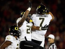 PALO ALTO, CA - NOVEMBER 14: Royce Freeman #21 and Darren Carrington #7 of the Oregon Ducks celebrate after Freeman score a touchdown against the Stanford Cardinal at Stanford Stadium on November 14, 2015 in Palo Alto, California. (Photo by Ezra Shaw/Getty Images)
