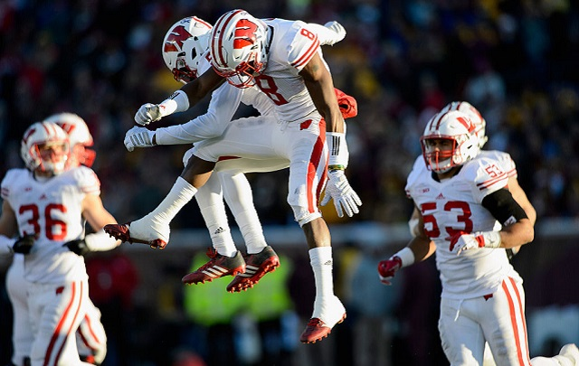 MINNEAPOLIS, MN - NOVEMBER 28: Darius Hillary #5 and Sojourn Shelton #8 of the Wisconsin Badgers celebrate a fumble recovery by Hillary against the Minnesota Golden Gophers during the second quarter of the game on November 28, 2015 at TCF Bank Stadium in Minneapolis, Minnesota. (Photo by Hannah Foslien/Getty Images)