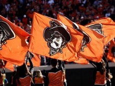 STILLWATER, OK - NOVEMBER 7:  Members of the Oklahoma State Cowboys spirit squad perform before the game against the TCU Horned Frogs November 7, 2015 at Boone Pickens Stadium in Stillwater, Oklahoma. The Cowboys defeated the Horned Frogs 49-29. (Photo by Brett Deering/Getty Images)