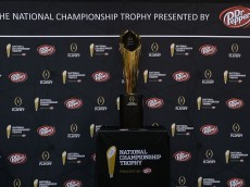 PHOENIX, AZ - JANUARY 09:  The College Football National Championship trophy sits on display during Media Day for the College Football Playoff National Championship at Phoenix Convention Center on January 9, 2016 in Phoenix, Arizona.  (Photo by Jennifer Stewart/Getty Images)