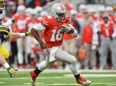 COLUMBUS, OH - NOVEMBER 29:  Quarterback J.T. Barrett #16 of the Ohio State Buckeyes breaks free for a 25-yard touchdown run against the Michigan Wolverines in the second quarter at Ohio Stadium on November 29, 2014 in Columbus, Ohio.  (Photo by Jamie Sabau/Getty Images)