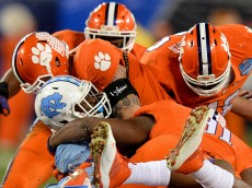 North Carolina tailback Elijah Hood is swarmed by the Clemson defense on a run during second-quarter action during the ACC Football Championship at Bank of America Stadium in Charlotte, N.C., on Saturday, Dec. 5, 2015. (Jeff Siner/Charlotte Observer/TNS via Getty Images)