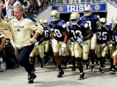 Notre Dame coach Brian Kelly leads the team onto the field for an NCAA college football game against Purdue in South Bend, Ind., Saturday, Sept. 4, 2010. (AP Photo/Darron Cummings)
