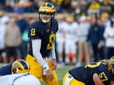 ANN ARBOR, MI - APRIL 01: John O'Korn #8 of the Michigan Wolverines gets ready to run a play during the Michigan Football Spring Game on April 1, 2016 at Michigan Stadium in Ann Arbor, Michigan.  (Photo by Gregory Shamus/Getty Images)
