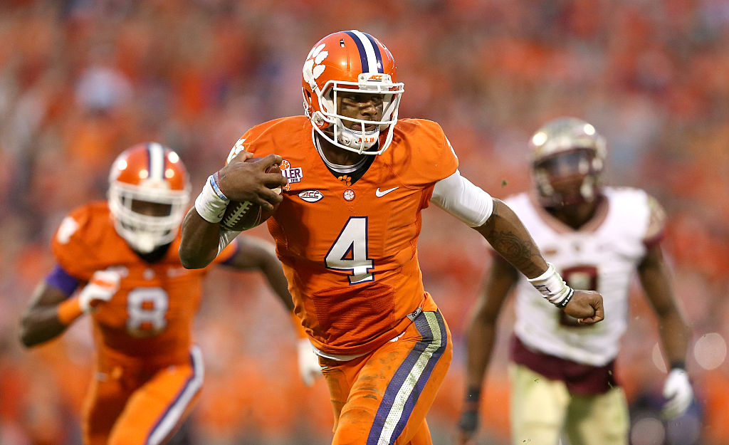 CLEMSON, SC - NOVEMBER 07:  Deshaun Watson #4 of the Clemson Tigers runs with the ball against the Florida State Seminoles during their game at Memorial Stadium on November 7, 2015 in Clemson, South Carolina.  (Photo by Streeter Lecka/Getty Images)
