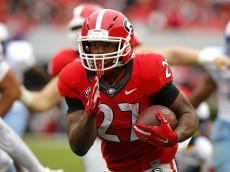 ATHENS, GA - SEPTEMBER 26: Running back Nick Chubb #27 of the Georgia Bulldogs rushes in for a touchdown in the third quarter of the game against the Southern University Jaguars on September 26, 2015 at Sanford Stadium in Athens, Georgia. The Georgia Bulldogs won 48-6. (Photo by Todd Kirkland/Getty Images)