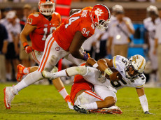 ATLANTA, GA - SEPTEMBER 22:  Justin Thomas #5 of the Georgia Tech Yellow Jackets is sacked by Ryan Carter #31 of the Clemson Tigers at Bobby Dodd Stadium on September 22, 2016 in Atlanta, Georgia.  (Photo by Kevin C. Cox/Getty Images)