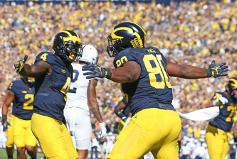 ANN ARBOR, MI - SEPTEMBER 24: Khalid Hill #80 of the Michigan Wolverines celebrates after scoring a touchdown with teammate De'Veon Smith #4 during the first quarter of the game against the Penn State Nittany Lions at Michigan Stadium on September 24, 2016 in Ann Arbor, Michigan (Photo by Leon Halip/Getty Images)