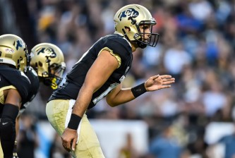DENVER, CO - SEPTEMBER 2:  Quarterback Sefo Liufau #13 of the Colorado Buffaloes runs the offense against the Colorado State Rams during a game at Sports Authority Field at Mile High on September 2, 2016 in Denver, Colorado.  (Photo by Dustin Bradford/Getty Images)
