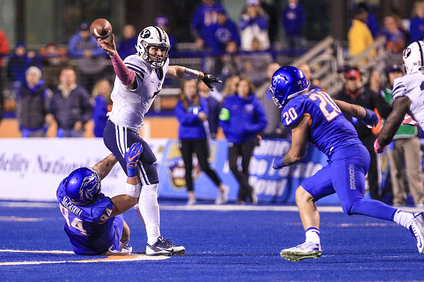 BOISE, ID - OCTOBER 20: Quarterback Taysom Hill #7 of the Brigham Young Cougars gets a pass off while in the grasp of defensive end Sam McCaskill #94 of the Boise State Broncos during second half action on October 20, 2016 at Albertsons Stadium in Boise, Idaho. Boise State won the game 28-27. (Photo by Loren Orr/Getty Images)