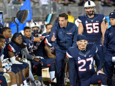 Connecticut head coach Bob Diaco tries to get the team pumped up late in the fourth quarter against Tulane at Rentcschler Field in Hartford, Conn. Tulane won, 38-13. (Peter Casolino/Hartford Courant/TNS via Getty Images)