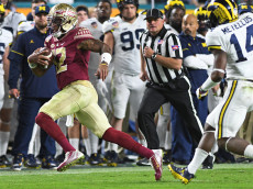 Florida State quarterback Deondre Francois (12) runs for a first down against Michiganduring the first half of the Capital One Orange Bowl on Friday, Dec. 30, 2016, at Hard Rock Stadium in Miami Gardens, Fla. (Jim Rassol/Sun Sentinel/TNS via Getty Images)