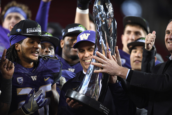 SANTA CLARA, CA - DECEMBER 02:  Head coach Chris Petersen of the Washington Huskies is awarded the Pac-12 Championship game trophy after they beat the Colorado Buffaloes at Levi's Stadium on December 2, 2016 in Santa Clara, California.  (Photo by Thearon W. Henderson/Getty Images)