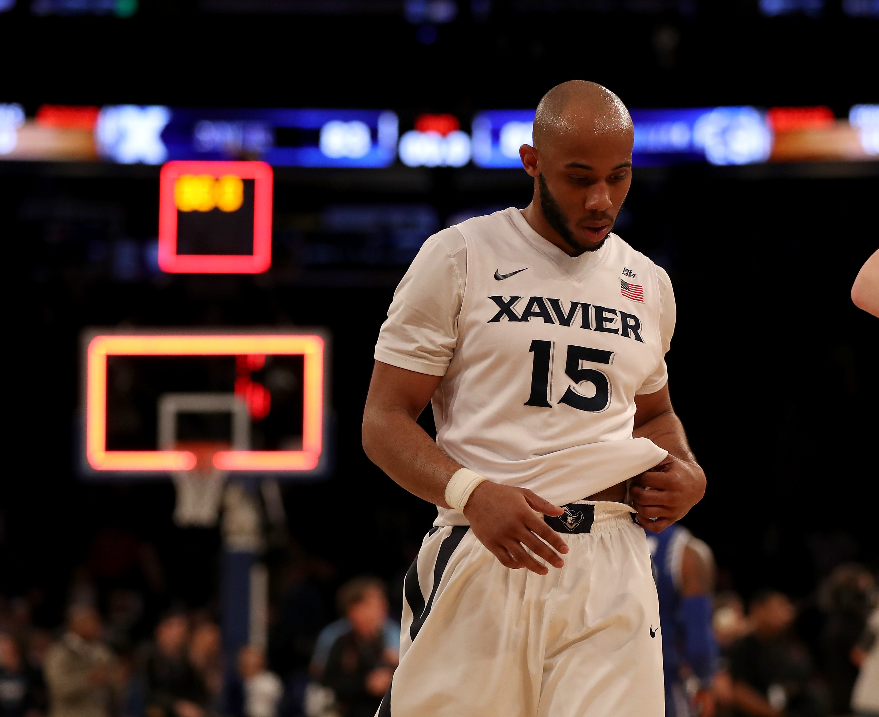 NEW YORK, NY - MARCH 11:  Myles Davis #15 of the Xavier Musketeers walks off the court after the loss to the Seton Hall Pirates during the semifinals of the Big East Basketball Tournament on March 11, 2016  at Madison Square Garden in New York City.The Seton Hall Pirates defeated the Xavier Musketeers 87-83.  (Photo by Elsa/Getty Images)