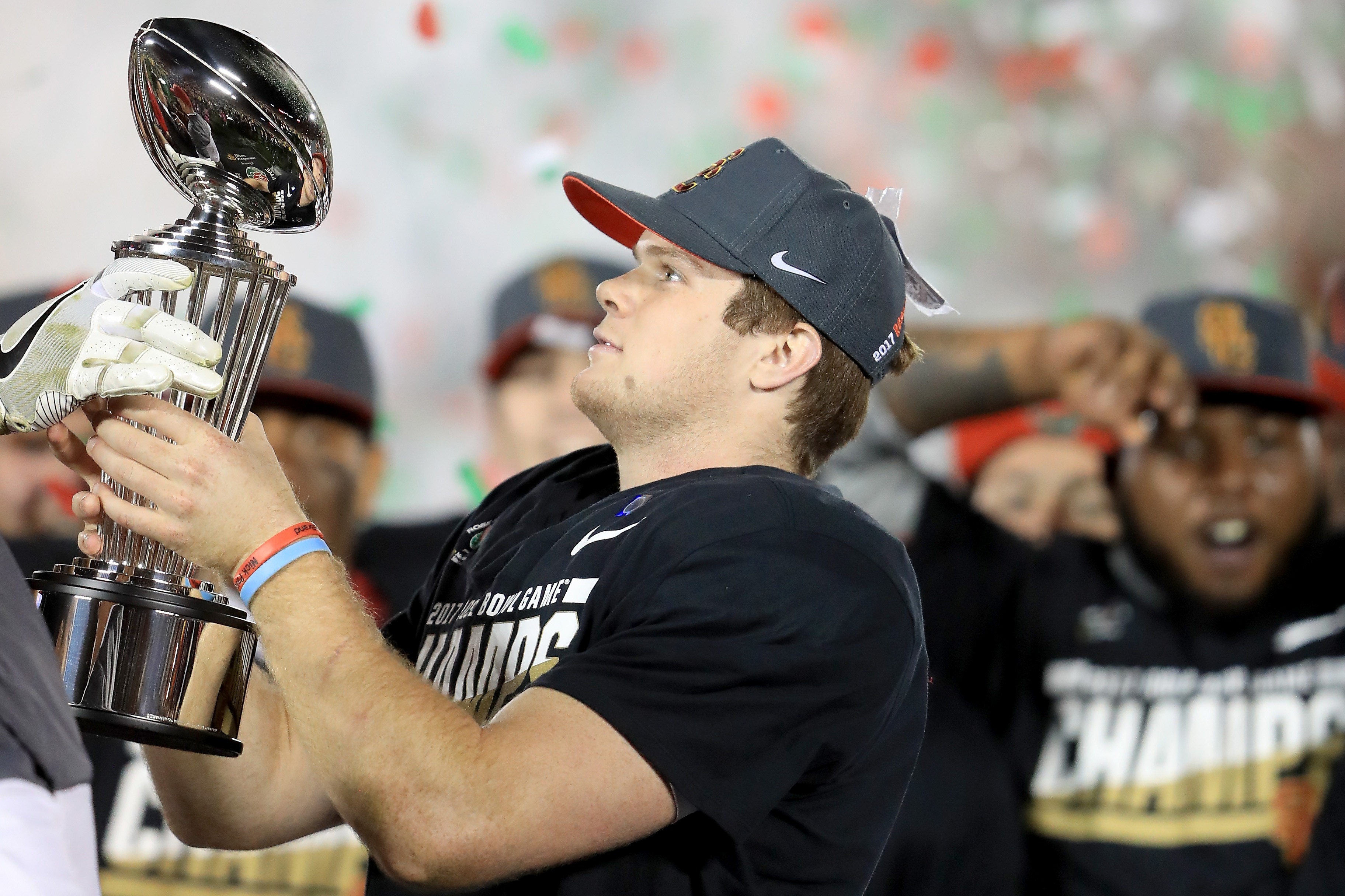 PASADENA, CA - JANUARY 02:  Quarterback Sam Darnold #14 of the USC Trojans celebrates with the 2017 Rose Bowl trophy after defeating the Penn State Nittany Lions 52-49 to win the 2017 Rose Bowl Game presented by Northwestern Mutual at the Rose Bowl on January 2, 2017 in Pasadena, California.  (Photo by Sean M. Haffey/Getty Images)