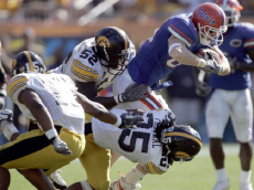 Florida tight end Tate Casey is wrapped up by Iowa defenders Abdul Hodge (#52) and Marcus Paschal (#25) during Monday's Outback Bowl in Tampa, Florida on January 2, 2006. (Photo by J. Meric/WireImage)