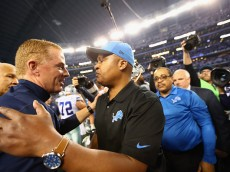 ARLINGTON, TX - JANUARY 04:  Head coach Jason Garrett of the Dallas Cowboys greets Jim Caldwell of the Detroit Lions after their NFC Wild Card Playoff game at AT&T Stadium on January 4, 2015 in Arlington, Texas.  The Cowboys defeated the Lions 24-20.  (Photo by Ronald Martinez/Getty Images)