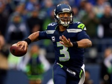 SEATTLE, WA - JANUARY 19:  Quarterback Russell Wilson #3 of the Seattle Seahawks looks to pass in the first quarter against the San Francisco 49ers during the 2014 NFC Championship at CenturyLink Field on January 19, 2014 in Seattle, Washington.  (Photo by Ronald Martinez/Getty Images)