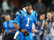 ARLINGTON, TX - NOVEMBER 26:  Cam Newton #1 of the Carolina Panthers runs with a camera after a 33-14 win against the Dallas Cowboys at AT&T Stadium on November 26, 2015 in Arlington, Texas.  (Photo by Ronald Martinez/Getty Images)