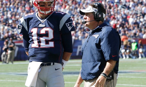 FOXBORO, MA - SEPTEMBER 22: Bill Belichick of the New England Patriots confers with Tom Brady #12 during a time out in the 2nd half in a game with the Tampa Bay Buccaneers at Gillette Stadium on September 22, 2013 in Foxboro, Massachusetts. (Photo by Jim Rogash/Getty Images)