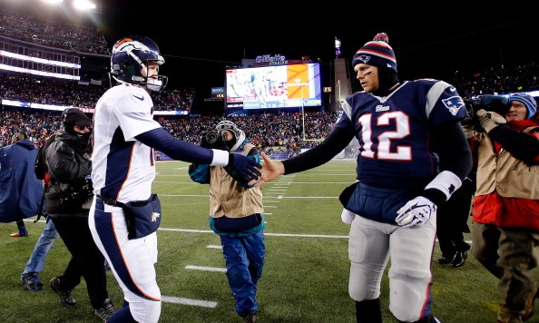 FOXBORO, MA - NOVEMBER 24: Quarterback Peyton Manning #18 of the Denver Broncos and quarterback Tom Brady #12 of the New England Patriots shake hands after the New England Patriots defeated the Denver Broncos 34-31 in overtime at Gillette Stadium on November 24, 2013 in Foxboro, Massachusetts.  (Photo by Jim Rogash/Getty Images)