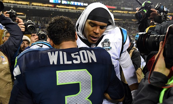 SEATTLE, WA - JANUARY 10:  Russell Wilson #3 of the Seattle Seahawks shakes hands with Cam Newton #1 of the Carolina Panthers after their 2015 NFC Divisional Playoff game at CenturyLink Field on January 10, 2015 in Seattle, Washington. The Seattle Seahawks defeated the Carolina Panthers 31 to 17.(Photo by Steve Dykes/Getty Images)