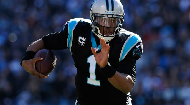 CHARLOTTE, NC - JANUARY 12: Cam Newton #1 of the Carolina Panthers runs with the ball in the second quarter against the San Francisco 49ers during the NFC Divisional Playoff Game at Bank of America Stadium on January 12, 2014 in Charlotte, North Carolina.  (Photo by Grant Halverson/Getty Images)