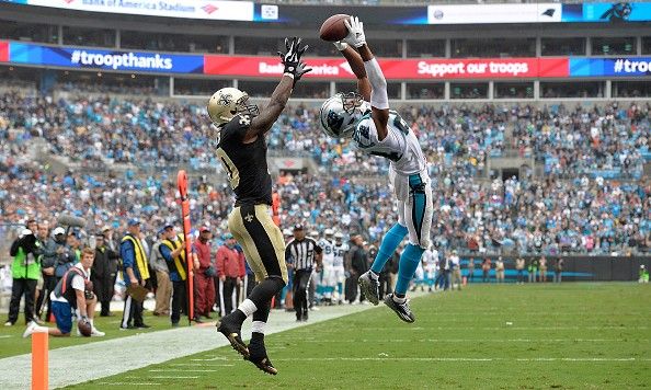 CHARLOTTE, NC - SEPTEMBER 27:  Josh Norman #24 of the Carolina Panthers makes a game-saving interception of a pass to Brandin Cooks #10 of the New Orleans Saints in the end zone during their game at Bank of America Stadium on September 27, 2015 in Charlotte, North Carolina. The Panthers won 27-25.  (Photo by Grant Halverson/Getty Images)