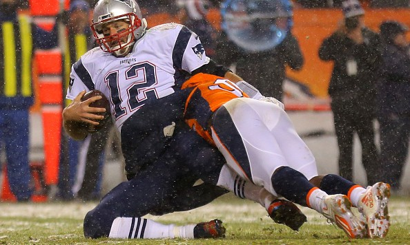DENVER, CO - NOVEMBER 29: Quarterback Tom Brady #12 of the New England Patriots is sacked by outside linebacker Von Miller #58 of the Denver Broncos in overtime at Sports Authority Field at Mile High on November 29, 2015 in Denver, Colorado. (Photo by Justin Edmonds/Getty Images)