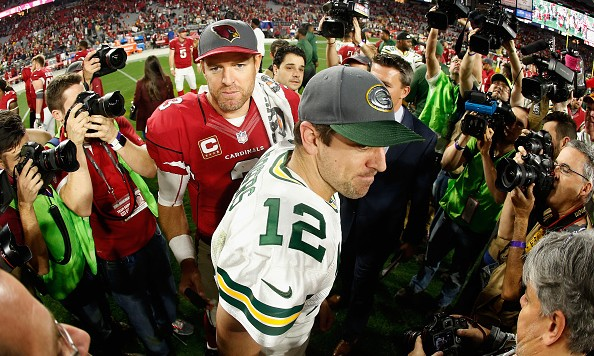 GLENDALE, AZ - DECEMBER 27:  Quarterbacks Carson Palmer #3 of the Arizona Cardinals and Aaron Rodgers #12 of the Green Bay Packers shake hands following the NFL game at the University of Phoenix Stadium on December 27, 2015 in Glendale, Arizona. The Cardinals defeated the Packers 38-8.   (Photo by Christian Petersen/Getty Images)