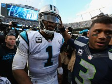 CHARLOTTE, NC - JANUARY 17:  Cam Newton #1 of the Carolina Panthers shakes hands with Russell Wilson #3 of the Seattle Seahawks after the NFC Divisional Playoff Game at Bank of America Stadium on January 17, 2016 in Charlotte, North Carolina. The Carolina Panthers defeated the Seattle Seahawks 31-24.  (Photo by Streeter Lecka/Getty Images)