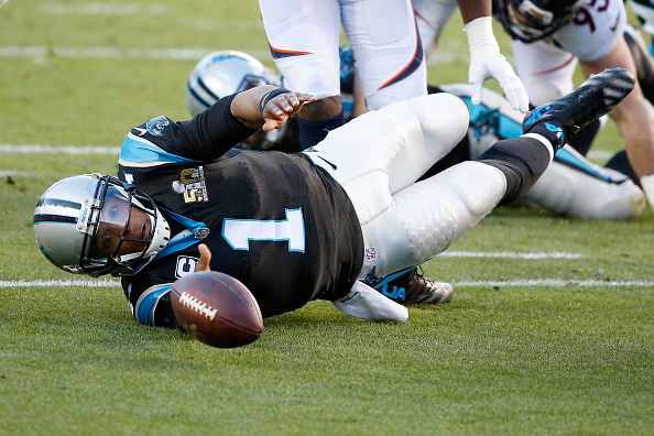 SANTA CLARA, CA - FEBRUARY 07:  Cam Newton #1 of the Carolina Panthers fumbles the ball in the first quarter of Super Bowl 50 at Levi's Stadium on February 7, 2016 in Santa Clara, California. The ball was recovered by Malik Jackson #97 of the Denver Broncos in the end zone for a touchdown. (Photo by Sean M. Haffey/Getty Images)